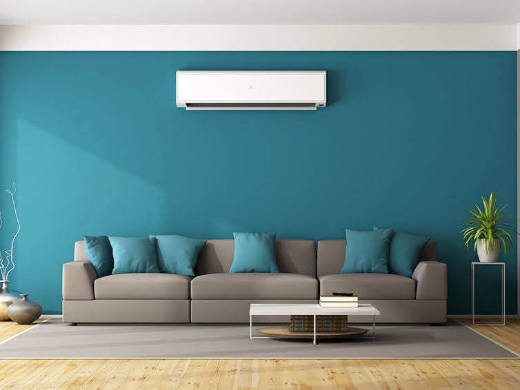 split system heating unit on home wall